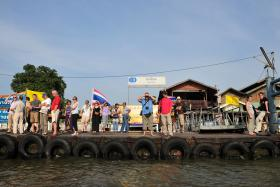 File photo of tourists and locals waiting for a river boat along the Chao Phraya river in Bangkok, Thailand.