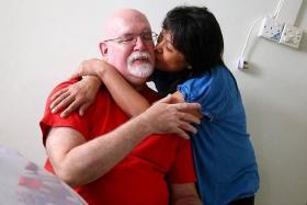 SUPPORT: Mr Bernie Utchenik's wife Faudziah Mohd Ali was his rock during tough times. She never judged him, he said.