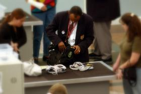 File photo of an airport security check employee searching a bag.