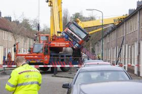 A crane fell on to the roof of a house in the town of Ijsselstein in the Netherlands.
