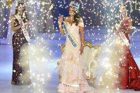 Rolene Strauss of South Africa (C) is crowned Miss World 2014, as Elizabeth Safrit of the U.S. (R) and Edina Kulczar of Hungary (L) who placed third and second respectively, look on at the ExCel Centre in east London, December 14, 2014. Contestants from 126 countries are in London to compete in the 2014 Miss World competition, the 63rd time the annual event has taken place.