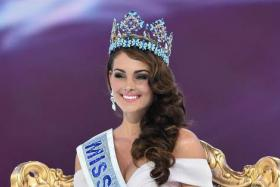 Miss South Africa and the 2014 Miss World, Rolene Strauss, poses in her seat after being crowned during the grand final of the Miss World 2014 pageant.