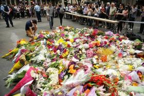 Sydney residents flock to florists to buy flowers to pay tribute to the victims of the Sydney siege.