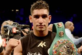Amir Khan celebrates his 12-round unanimous decision over Devon Alexander during their welterweight bout at the MGM Grand Garden Arena on December 13.
