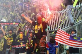 Malaysian fans at the Bukit Jalil Stadium in 2011.