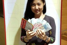 BIG WINNER: Madam Helen Teo Sock Kuan with the $9,000 jackpot prize.