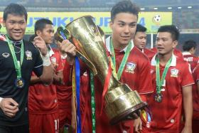 Charyl Chappuis holds the Suzuki Cup.