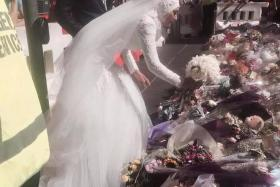 Manal Kassem was adorned in a white dress, hijab and veil when she laid her wedding bouquet on the river of floral tributes to the fatal Lindt cafe siege victims.