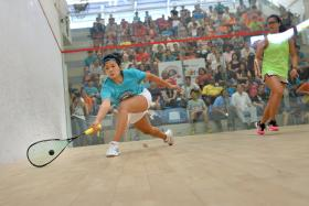 COMPETITIVE: Singapore's Mao Shi Hui (left) in action against Malaysia's Rachel Arnold yesterday.