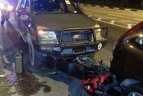 ACCIDENT: (Above) The motorcycle ended up wedged between the army vehicle and a car in front of the motorcycle. The couple were warded for several days.