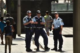 Police patrolling the street in Sydney's central business district on Wednesday.
