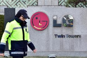 A policeman walking past the headquarters of LG Group in Seoul on Dec 26.