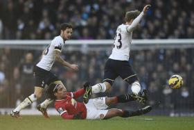 TACKLE: Man United's Radamel Falcao (centre) challenging Tottenham's Christian Eriksen (right) during their match.