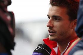 Critically injured French Formula One driver Jules Bianchi is no longer in an artificial coma but remains unconscious.