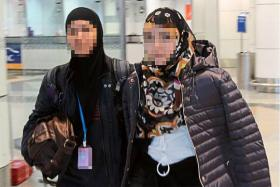 A 27-year-old Malaysian wo­­man was arrested on the eve of Christ­­mas at Kuala Lumpur International Airport for suspected links to the Islamic State in Iraq and Syria.
