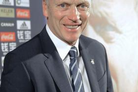 David Moyes, seen here at his official unveiling as Real Sociedad boss, would have every reason to be smiling after his side beat Barcelona on Monday morning.
