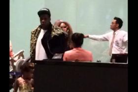Passing through Singapore were power couple Jay Z and Beyonce (the big hair poking from behind Jay Z).