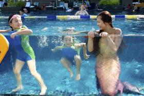 MAKING A SPLASH: Ms Cara Nicole Neo dresses up as Mermaid Syrena for children's parties and corporate events.