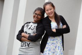 BEST FRIENDS: Rosny Pooja (left) and Pang Yue Yun have been living at Chen Su Lan Methodist Children's Home.