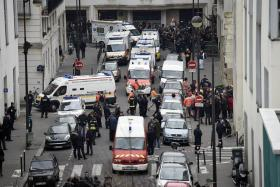 Authorities in front of the offices of the French satirical newspaper Charlie Hebdo in Paris on Jan 7, 2015, after armed gunmen stormed the offices leaving twelve dead.