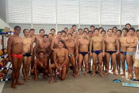 HELPING HAND: Singapore's men's water polo team with their Japanese sparring partners from Tsukuba University.