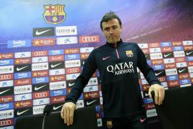 Barcelona's coach Luis Enrique Martinez takes a seat as he arrives for a press conference at the Sports Center FC Barcelona Joan Gamper in Sant Joan Despi, near Barcelona on January 7, 2015.