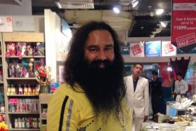 Indian spiritual guru Gurmeet Ram Rahim poses for a photograph after he was spotted at a shopping mall in New Delhi on Jan 5, 2015.
