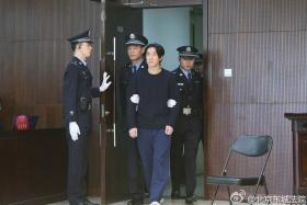Actor Jaycee Chan walks into court in Beijing January 9, 2015. Jaycee Chan, the son of kung fu movie star Jackie Chan, was jailed for six months in China on Friday on a drugs charge, the latest celebrity felled by the government's aggressive anti-narcotics campaign.