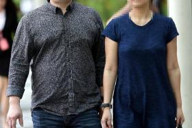 SHOCK: Tan Tee Wee (seen here with an unidentified woman) was found dead in a 12th-storey apartment at the Hilltops condominiumat Cairnhill Circle.
