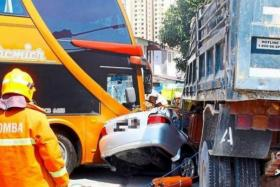Lorry rams into four cars, a bus and a truck. A teacher and the brother-in-law were crushed to death.