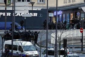 Members of the French police special forces launching an assault at Jewish supermarket.
