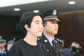 This handout photo taken on January 9, 2015 and released by the official weibo account of Beijing's Dongcheng District People's Court shows Jaycee Chan (C), son of kung fu star Jackie Chan, during his trial at the Dongcheng District People's Court in Beijing.