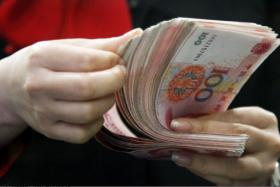 """The bank giveth and the bank taketh away: A 26-year-old man in Chuzhou city, China, had RMB8 billion (S$1.7 billion) transferred """"by mistake"""" into his bank account."""