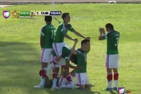 Mexico's Under-20 footballers form a human bicycle to celebrate their third goal against Cuba.
