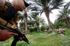Security forces personnel take part in clashes with Isis in the Middle East. Officials say some Malaysians have taken loans to pay for their passage to join Isis in Syria.