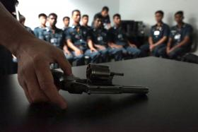TRAINING: Cisco trainees use a small-arms simulator (above), practise their footdrill and take part in an armed response drill.