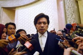 Defence lawyer Kamarul Hisham Kamaruddin addressing journalists after the verdict.