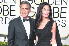 SOULMATES: Actor George Clooney and wife Amal arrive on the red carpet for the Golden Globe Awards at the Beverly Hilton Hotel in California, US, on Sunday night.