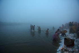 Hindu devotees taking a dip for the Makar Sankranti festival at Sangam, the confluence of the rivers Ganges, Yamuna and the mythical Saraswati, during a cold morning in Allahabad on Wednesday.