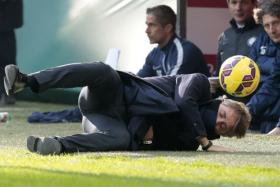 Roberto Mancini falls after being struck by a ball during the Italian Serie A.