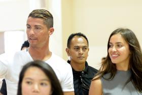 Cristiano Ronaldo and Irina Shayk visiting Crest Secondary School in 2013