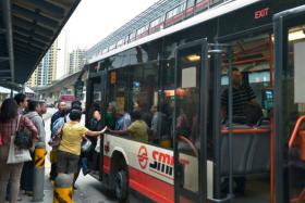 Commuters boarding a bus at the bus stop next to Clementi MRT along Clementi West Avenue on 17 January 2014. Public transport fares may drop next year (2016).