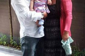 GRATEFUL: Baby Tandin Wangmo with with father Karma Tenzin and mother Tshearing Eden before the surgery (above).
