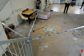 CRIME SCENE: The floor was stained with Mr Abdul Majid's blood.