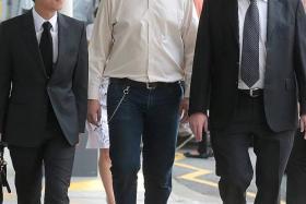 SENTENCED: David William Graaskov (centre) was sentenced to 15 months' probation yesterday.