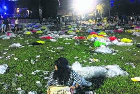 BEFORE & AFTER: (Above) The Meadow at Gardens by the Bay was litterfree before the start of Laneway Festival.