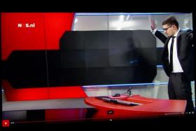 Still image taken from video on Jan 29 shows a pistol-wielding man standing in a TV studio of Dutch national broadcaster NOS in Amsterdam. He had forced his way into the studio, demanding to be allowed to go on air - but was quickly arrested.