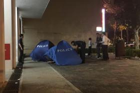 Policemen at the scene of the crime