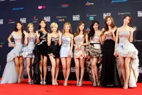 Surprise: K-pop idols are generally tight-lipped about their love life but Girls' Generation's Sunny (fourth from left) shared about her celebrity beau which caused further speculation as to who it could be.