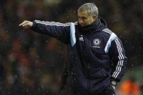 PARK THE BUS: Jose Mourinho (above) is an expert at setting teams up to avoid defeat, which is what he is likely to do against Man City.